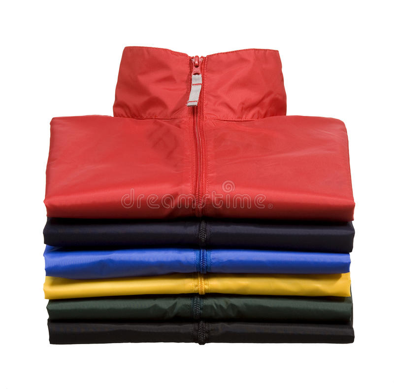 Stack of Windbreaker. A stack of windbreakers shot in the studio. The windbreakers are isolated in front of white background royalty free stock images