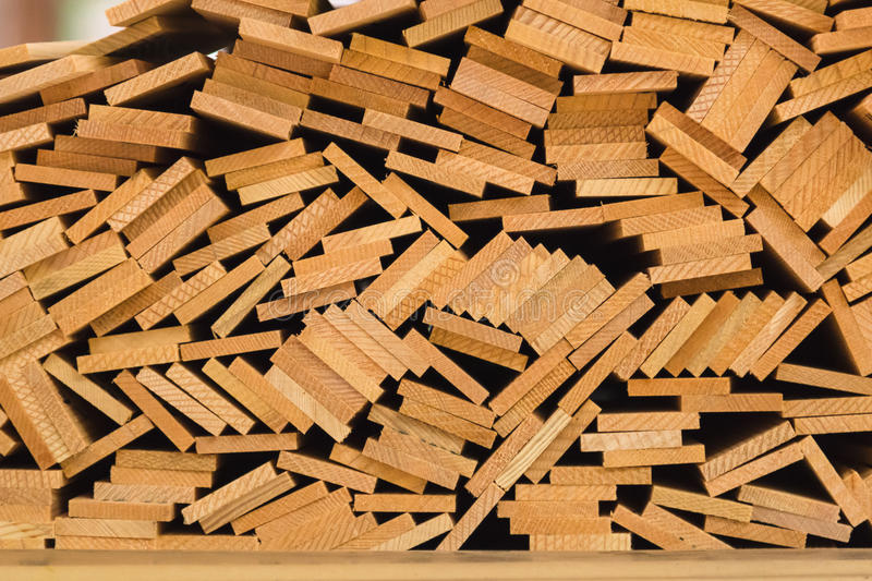 Stack of wood bars. Stack of wooden bars in construction site stock images