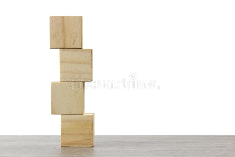 Stack of wooden block on wood table against white background.  royalty free stock photos