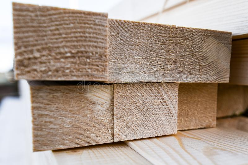 Wooden slats texture. Stack of wooden slats in timber logs storage stock photography