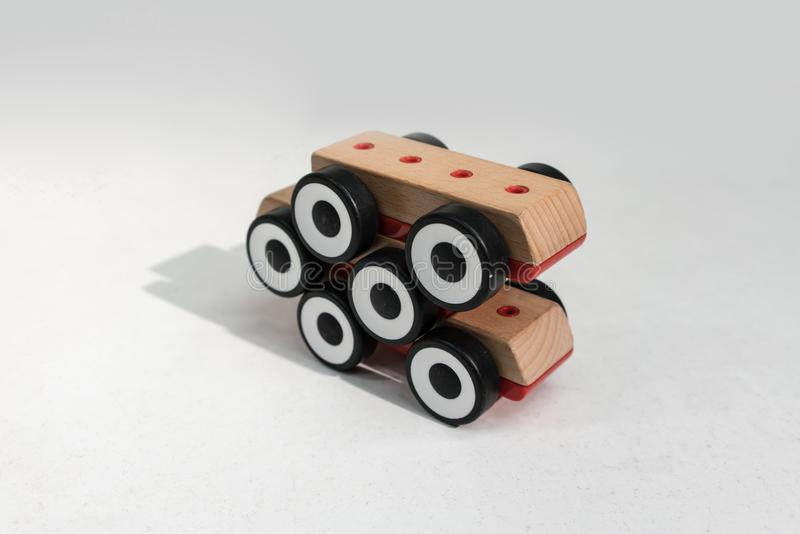 Stack of wooden toy cars with shadow in perspective view. Six w royalty free stock photos