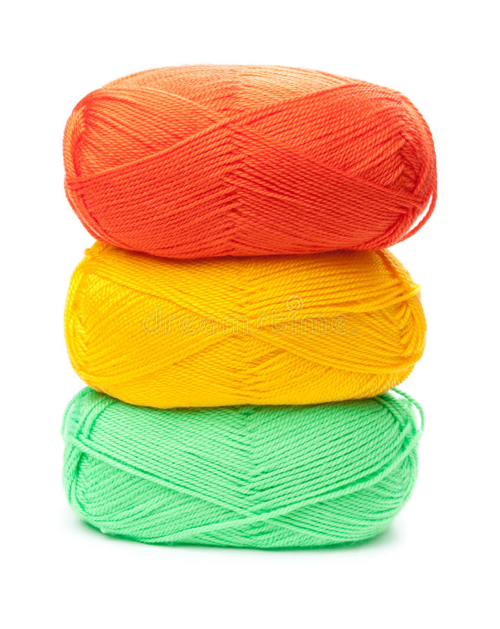 Stack of yarn skeins in yellow, orange, green colors. On white background stock photos