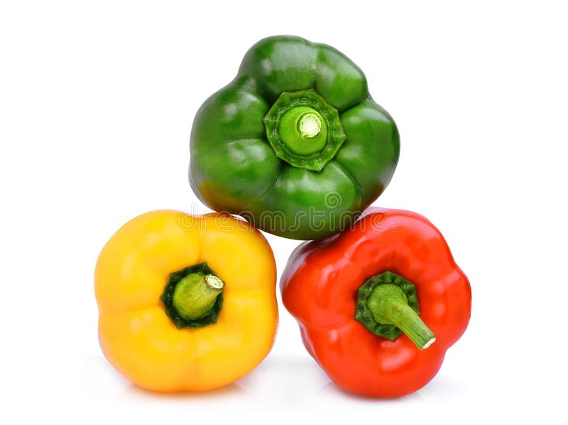 Stack of yellow,red,green, sweet bell pepper or capsicum isolate. D on white background stock image