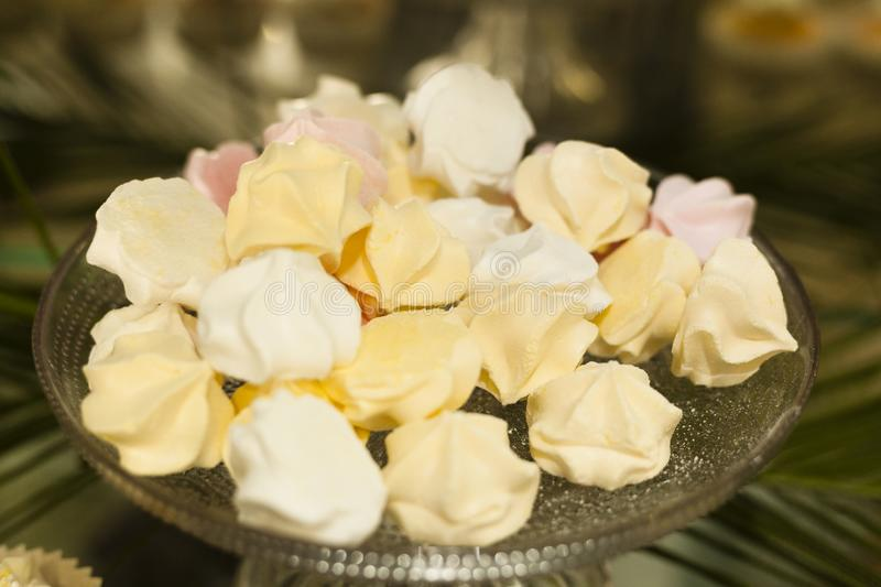 Stack of zephyr sweeties in glass vase. Isolated stock image