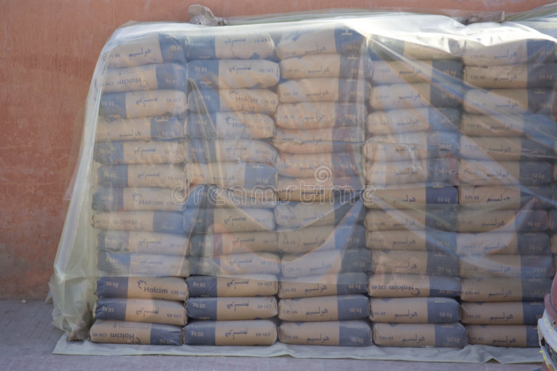 Stacked bags of cement stock photos