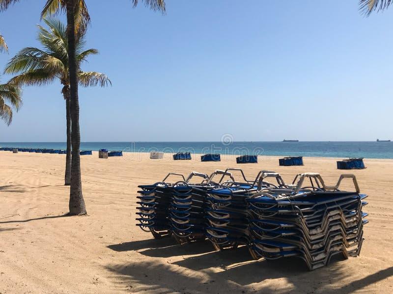 Stacked Beach Chairs Indicate Closed Florida Beach During Coronavirus Pandemic stock image