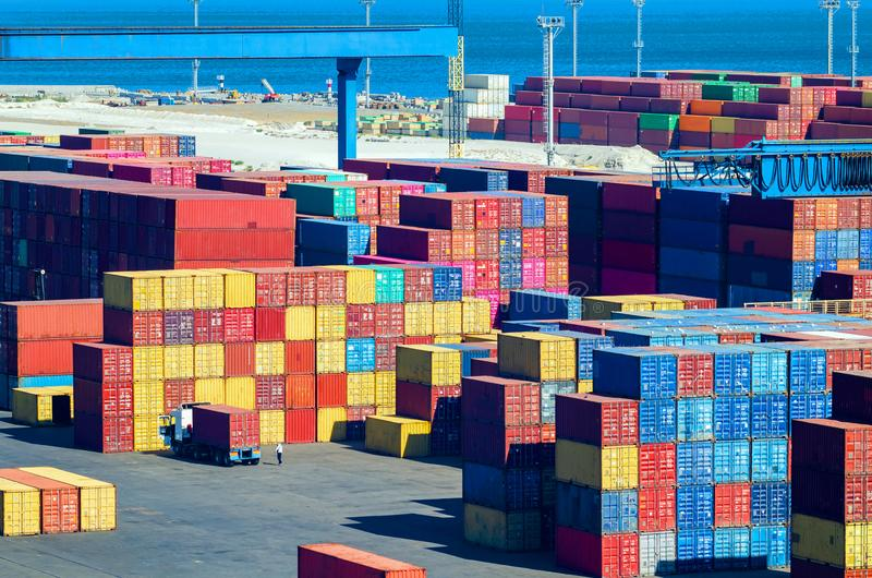Stacked cargo containers in storage area of freight sea port.  royalty free stock image