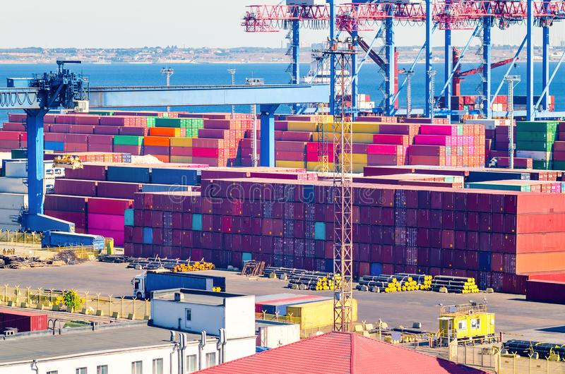 Stacked cargo containers in storage area of freight sea port.  royalty free stock photo
