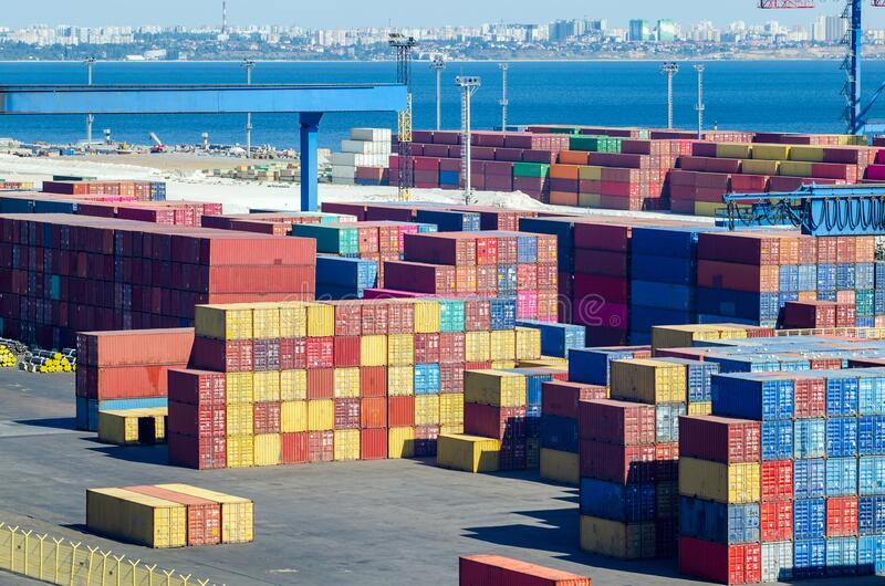 Stacked cargo containers in storage area of freight sea port.  royalty free stock photos