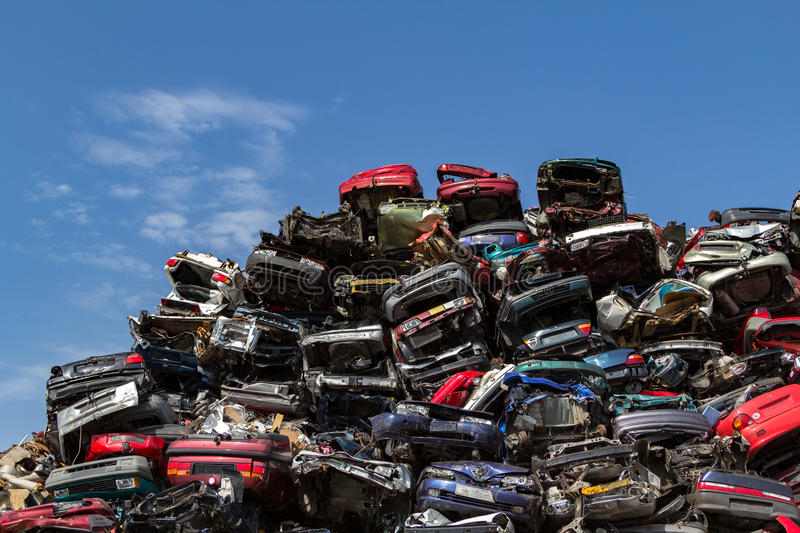 Stacked cars at a junkyard. Stacked and compressed cars ready for recycling at a junkyard in Amsterdam royalty free stock photo