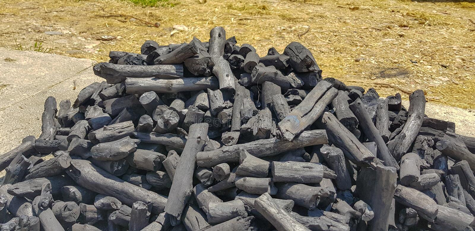 Stacked charcoal prepared for bonfire. Ash background barbecue bbq beef black blaze bright burn close-up closeup color dangerous ember embers energy fiery stock images