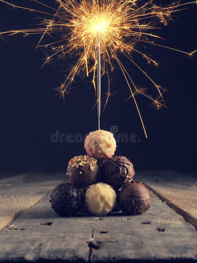Stacked chocolate balls with a sparkler stock photo