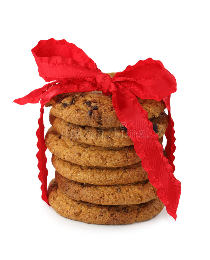 Stacked chocolate chip cookies. With red bow isolated on white background royalty free stock photos