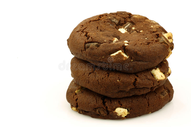 Stacked chocolate chip cookies with nuts stock photos