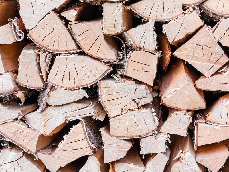 Stacked chopped birch firewood in woodpile, background texture. royalty free stock image