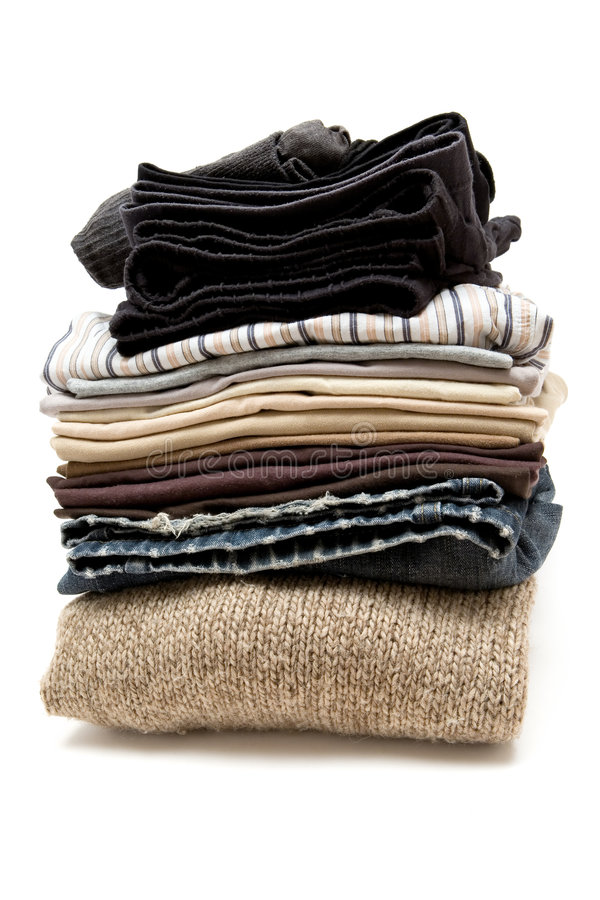 Stacked Clothes. Stack of various garments. White background royalty free stock image