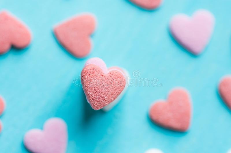 Stacked Colorful Pastel Sugar Candy Sprnikles on Light Blue Background. Valentine Mother`s Day Kid`s Charity Concept royalty free stock photography