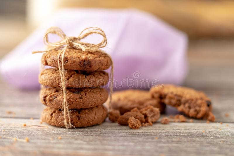 Stacked cookies use a rope tied on a wooden table stock images