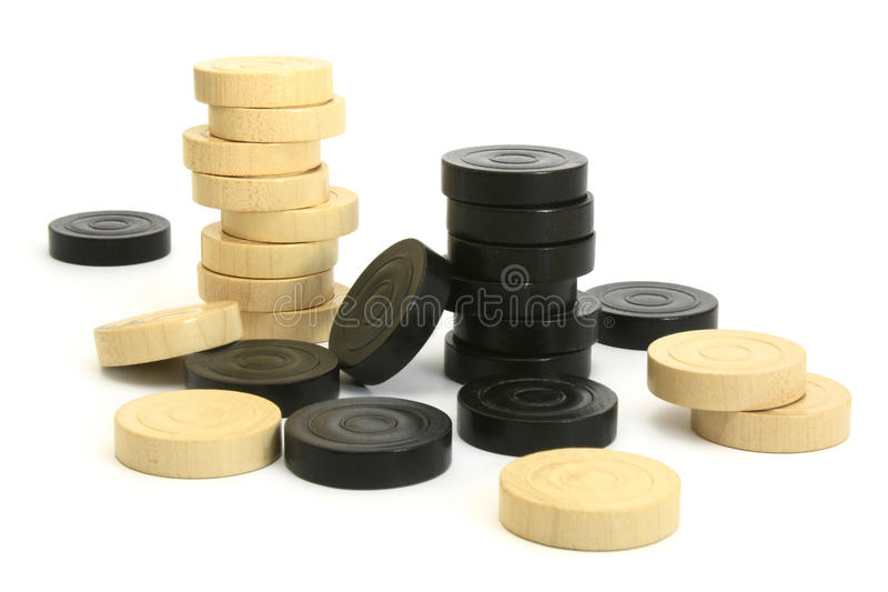 Stacked draught pieces stock images