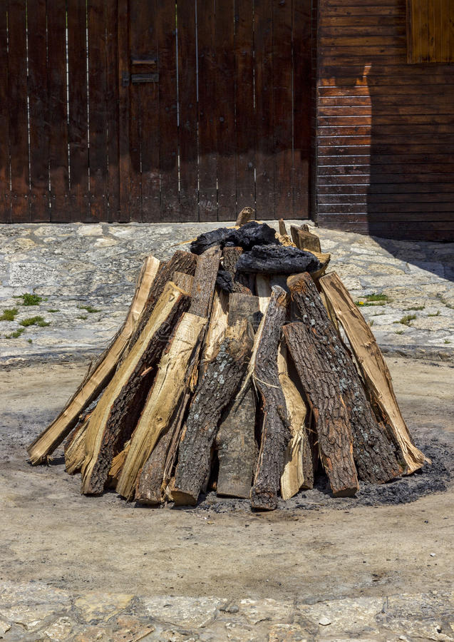 Stacked dry wood. Beauty stacked dry wood and coal for the hearth royalty free stock image