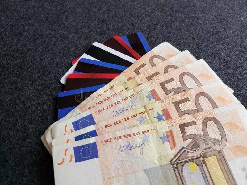 stacked 50 euro banknotes, credit and debit cards, background and texture stock image
