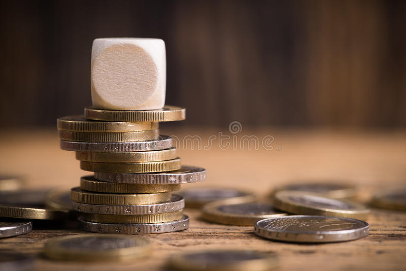 Stacked euro coins with empty cube royalty free stock image