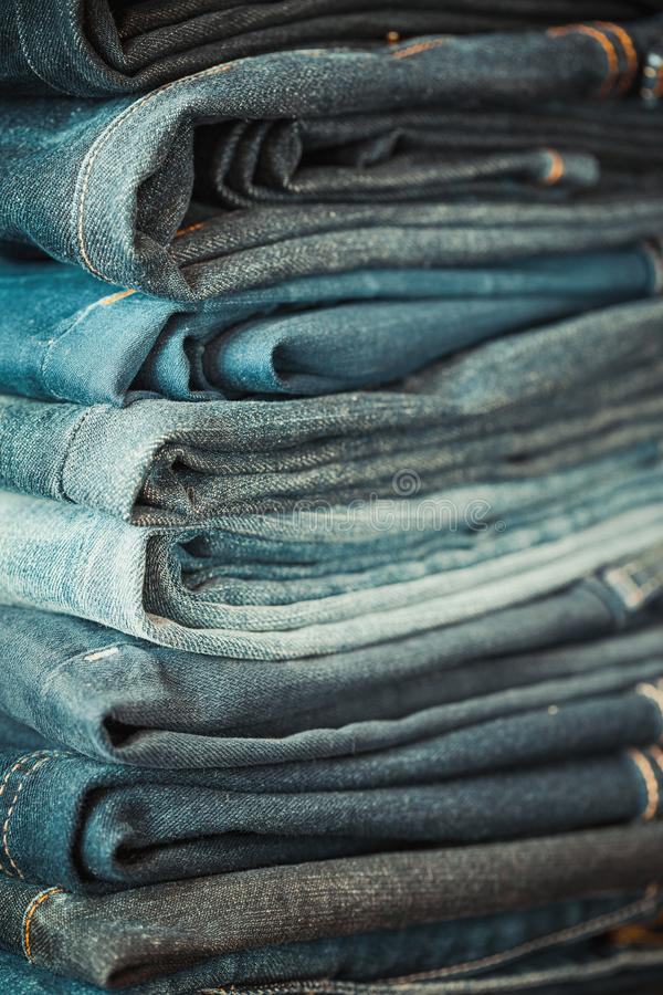 Stacked fashion jeans. Selective focus. Stacked fashion jeans close up. Selective focus stock photos