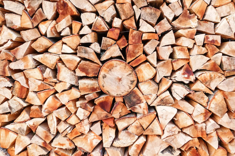 Stacked firewood background texture stock image