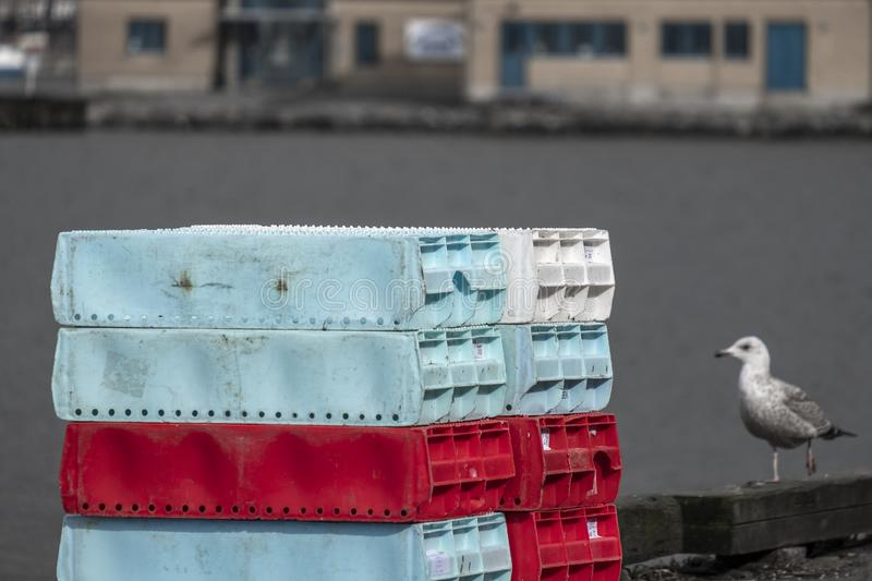 Stacked fishing boxes stock photos