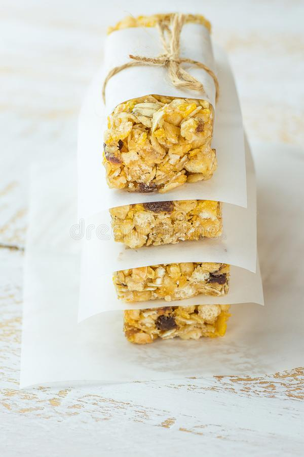 Stacked Homemade Granola Muesli Cereal Bars with Oats Nuts Raisins Honey Dried Apples. Lined with Parchment Paper Tied with Twine. stock image