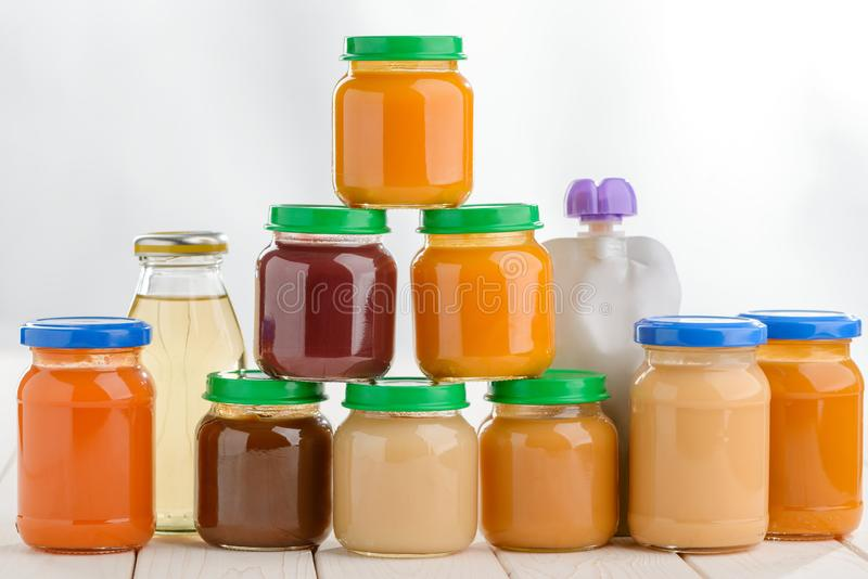 Stacked jars of baby food stock photos