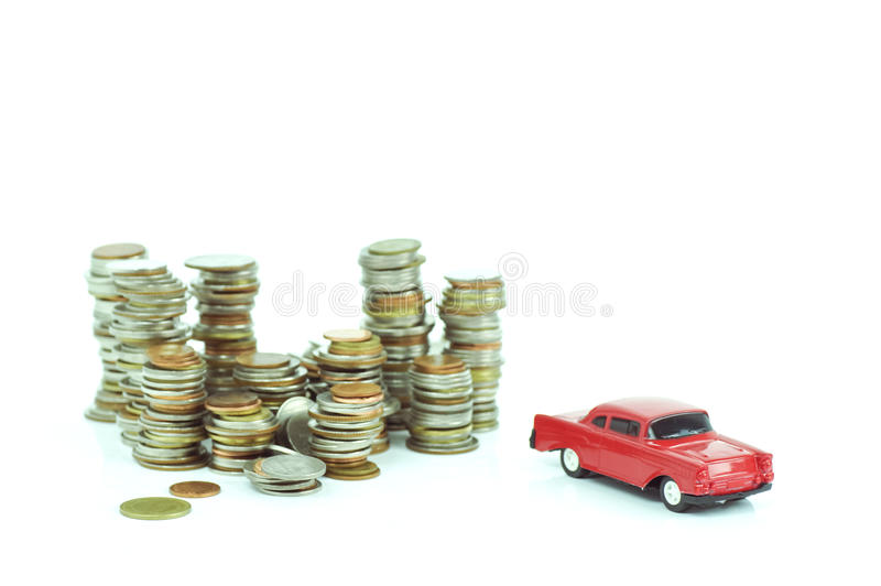 Stacked of money coins and red toy car. On white background royalty free stock images