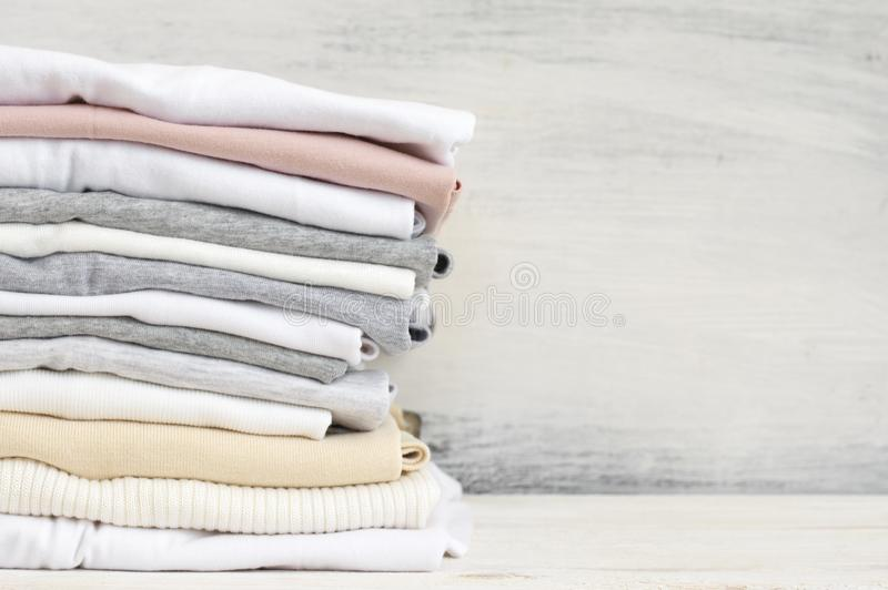 Stacked neutral colored t-shirts stock photos