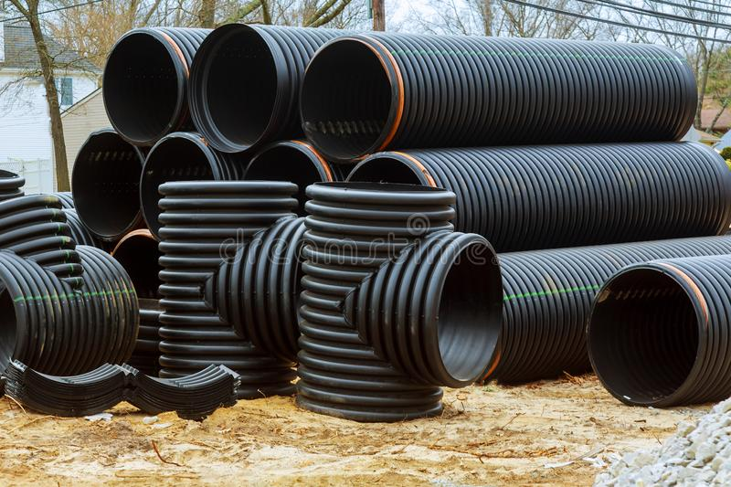 Stacked new PVC pipe on construction of housing project. Stacked new PVC pipe for under construction of housing project septic sewage canalization sewerage royalty free stock photos