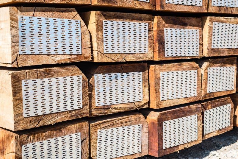 Stacked of new wooden railway sleepers stock photo