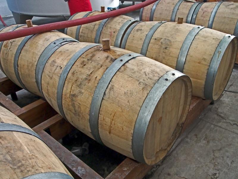 Stacked oak barrels for cognac. At a winery in Georgia royalty free stock photos