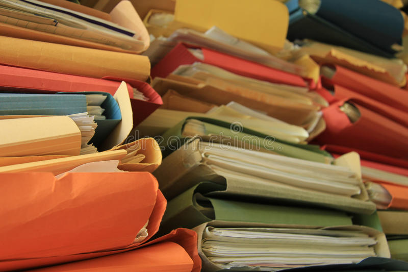 Stacked office files stock images