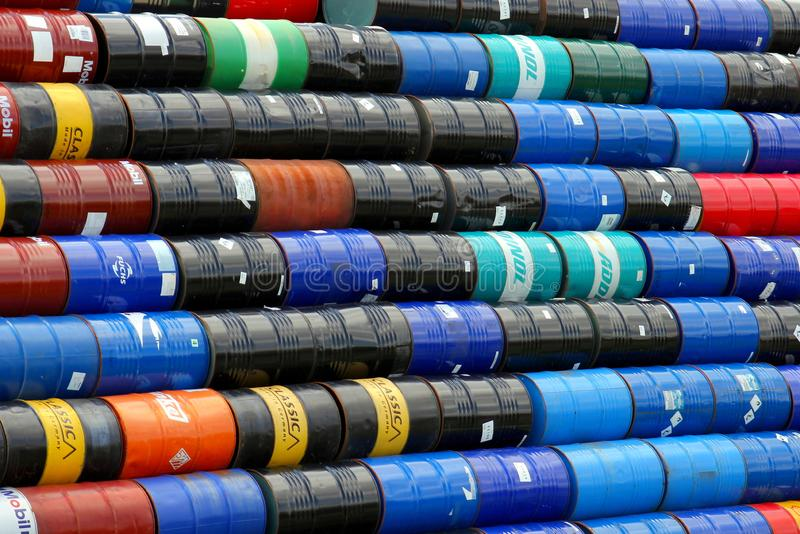 Stacked oil barrels. HAMBURG, GERMANY - JUNE 26, 2016: Variegated oil barrels stacked at a wholesaler`s site royalty free stock photography