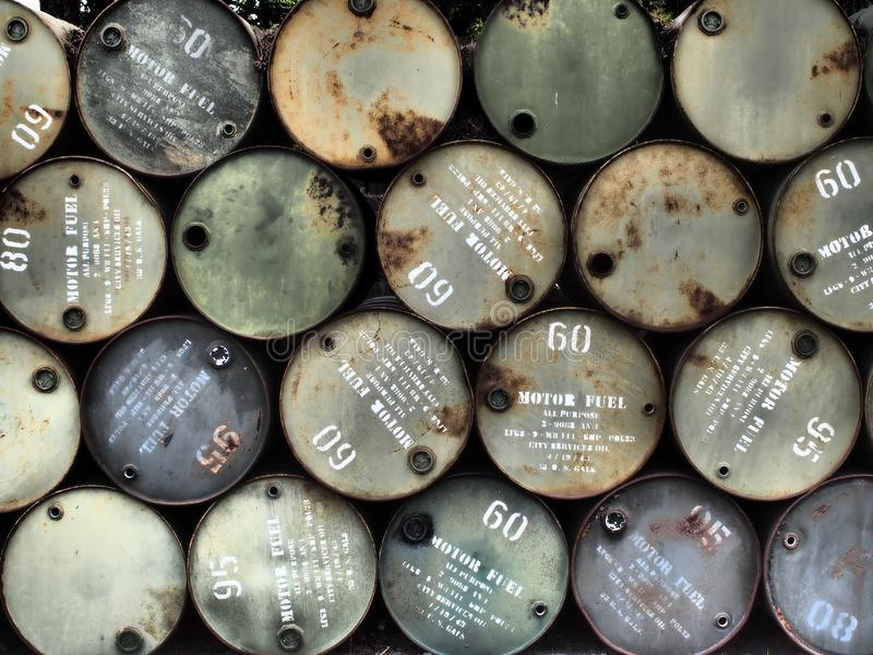 Stacked oil barrels stock photography