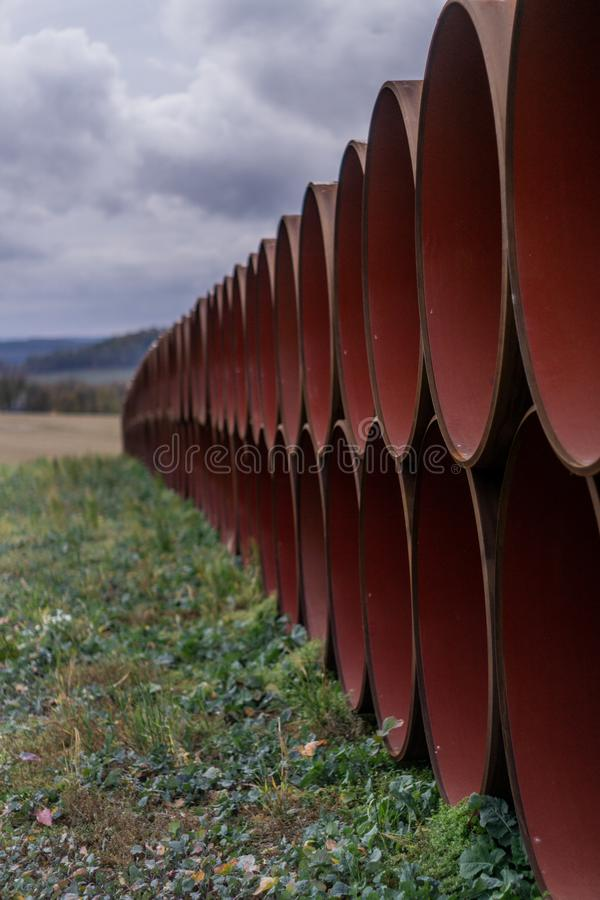 Stacked Oil pipes after production on a field. The waiting for transport to there destination stock photography