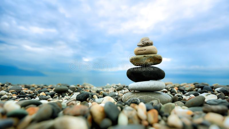 Stacked pebbles along the beach. This image is suitable for background use. It provides a feel of peacefulness, harmony, quietness and relaxation royalty free stock image