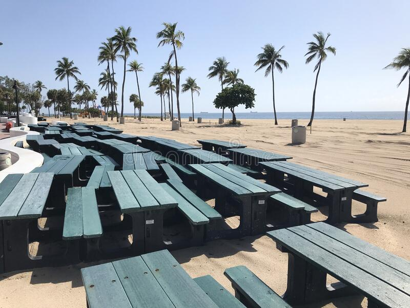 Stacked Picnic Tables Indicate Coronavirus Closure Of Fort Lauderdale Beach stock photo
