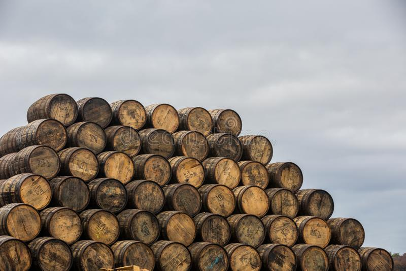Stacked pile of old wooden barrels and casks at Speyside Cooperage in Scotland stock photos