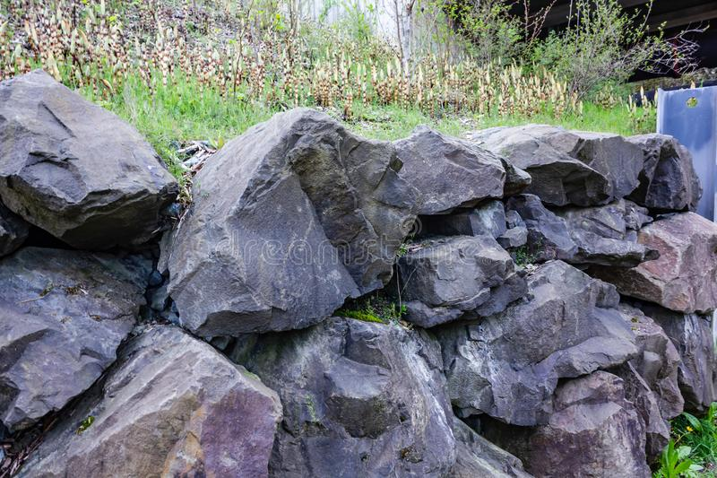 Stacked rock retaining wall stock photography