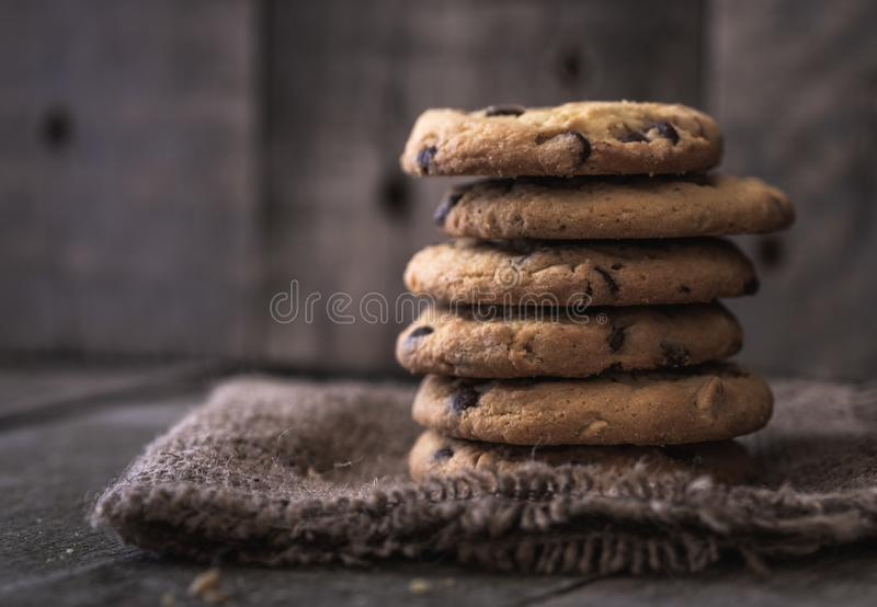 Stacked rounded chocolate cookies on natural old desk. royalty free stock image
