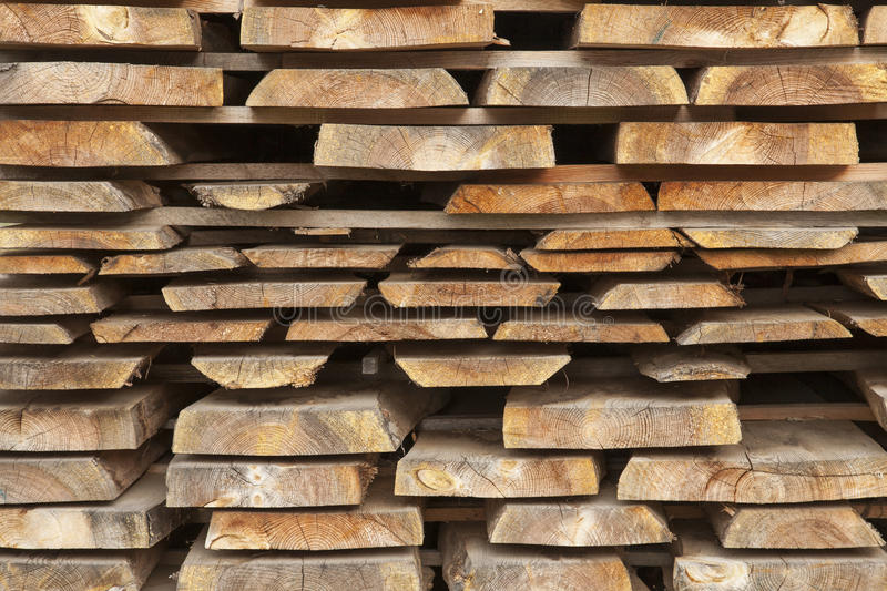Stacked sawed beech boards. Beech boards stored to dry outdoor royalty free stock photos