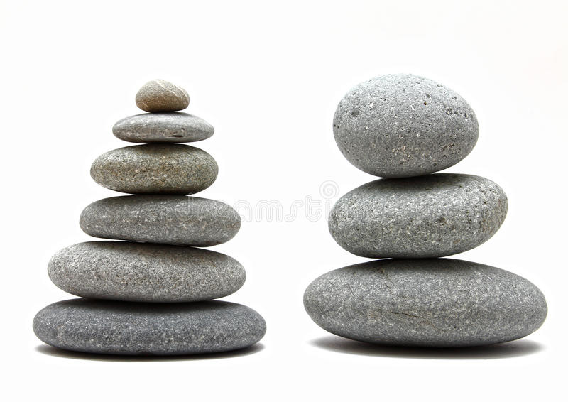 Stacked spa stones. Two stacked spa zen stones / rocks on white background