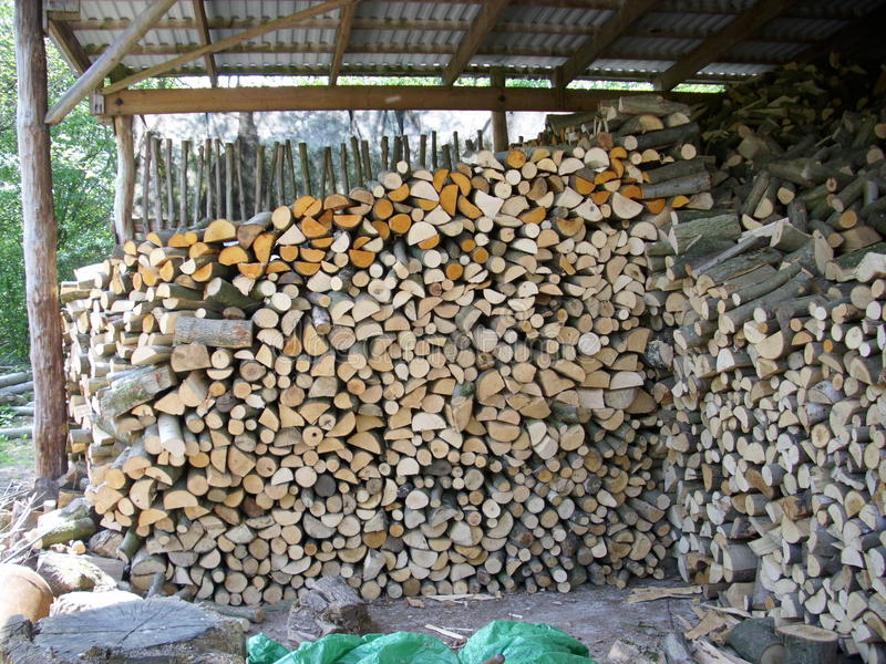 Firewood log stack. Coppiced and split logs drying and making an attractive collage of interlocked cut log ends. Could be used as a background texture royalty free stock images