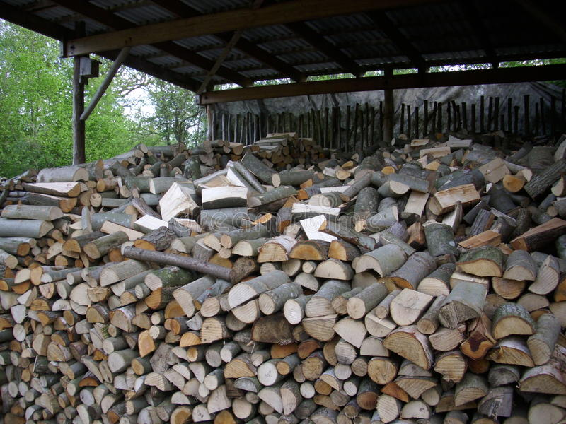 Firewood log stack. Coppiced and split logs drying and making an attractive collage of interlocked cut log ends. Could be used as a background texture stock photos