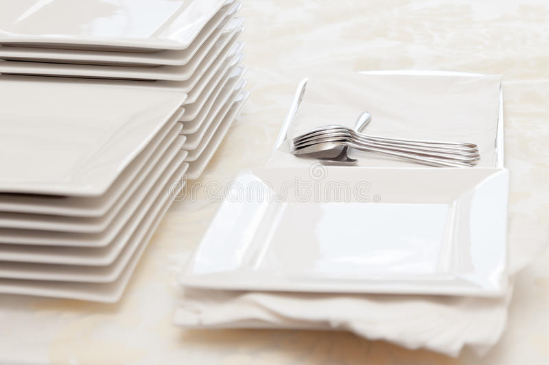 Stacked square plates stock photo